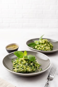 Zucchini vegan pasta on white background. vegetarian healthy food