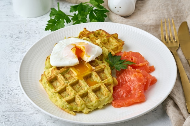 Zucchini waffles with salmon and benedict egg, fodmap diet side view closeup