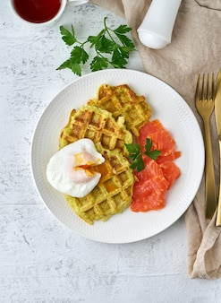 Zucchini waffles with salmon and benedict egg