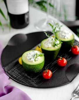 Zucchine con besciamella e pomodori