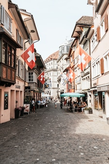 Zurich, switzerland - aug 23, 2018: augustinergasse pedestrian street with colorful buildings with cafe and restaurants in the old city center of zurich in switzerland