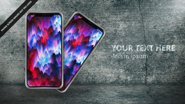 汚れたコンクリートの設定で2つのapple iphone x