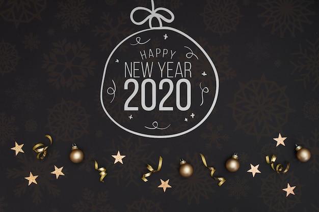 白い黒板落書き新年2020年テキストとクリスマスボール