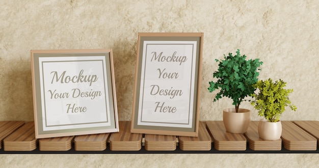植物と壁の棚に異なるサイズの2つのポスターフレームモックアップ