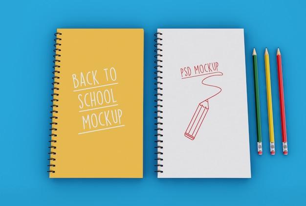 鉛筆モックアップテンプレートを持つ2つのスパイラルメモ帳