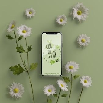 テーブルの上の携帯電話の周りの3 dの花