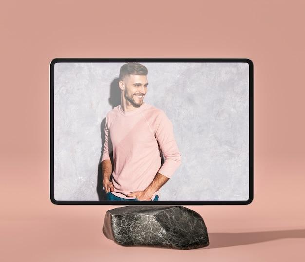大理石の岩の上の3 dモックアップデジタルタブレット