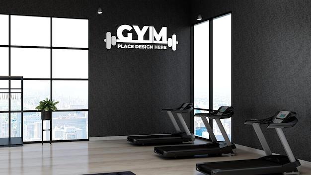 3d макет логотипа спортзала в фитнес-зале с черной стеной для спортсмена