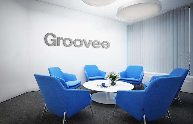 シンプルなクラシックビジネス屋内ワークスペースでの灰色の3d officeロゴのモックアップ