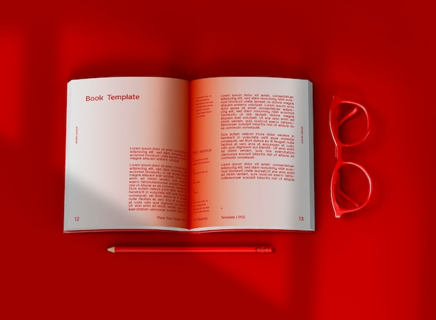 3d-макет открытой книги в твердом переплете с очками и карандашом