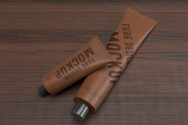 3d packaging design mockup of two lying vintage leather tubes