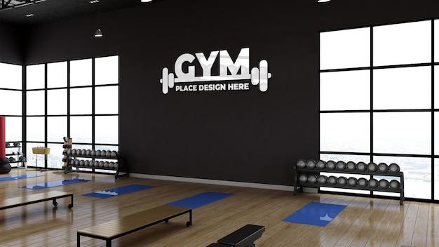 현실적인 벽 로고 모형이 있는 3d 렌더링 체육관