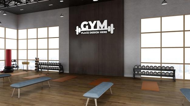 현실적인 나무 벽 스포츠 로고 모형이 있는 3d 렌더링 체육관