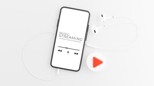 音楽ストリーミング コンセプト モックアップ デザインのイヤホン付きスマートフォンの 3 d レンダリング