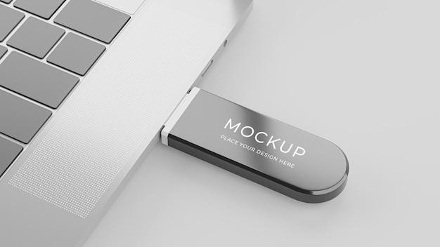ラップトップコンピューターのモックアップに接続されたusbフラッシュドライブの3dレンダリング