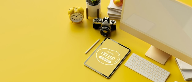 3d rendering of computer monitor digital tablet mockup screen camera and stationery on yellow background