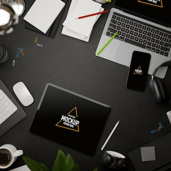 3d rendering dark creative flat lay workspace with tablet mockup