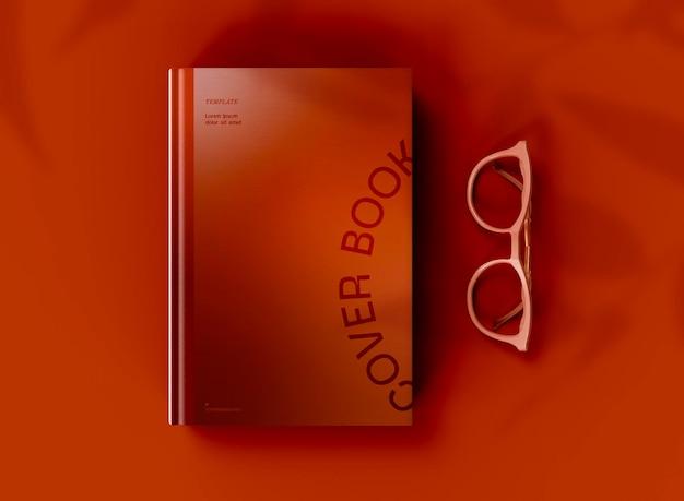 3d вид сверху макета книги в твердом переплете с очками