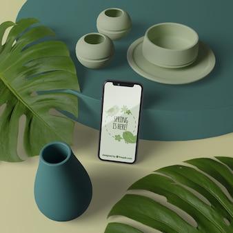 Vasi 3d con fiori accanto al telefono con mock-up