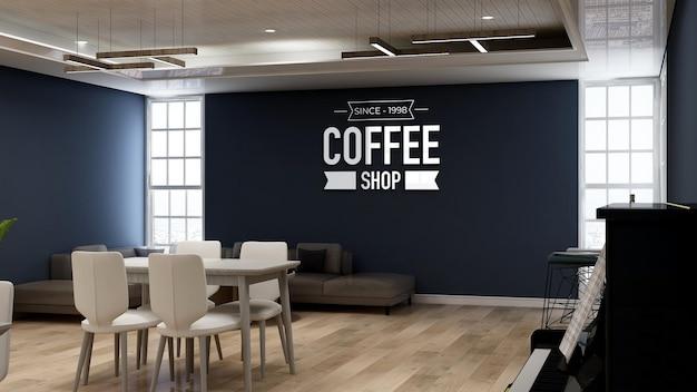 소파가 있는 커피숍의 3d 벽 로고 모형
