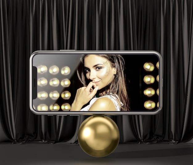 3d макет смартфона на золотом шаре