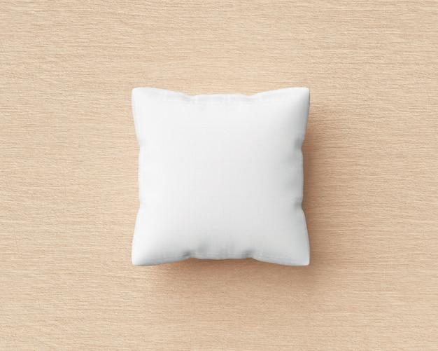 白い枕と空白のテンプレートと木製の床の背景に正方形の形。デザインの枕モックアップ。 3dレンダリング。