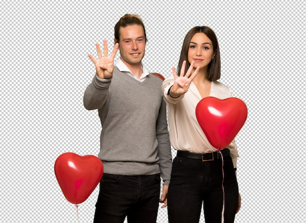 幸せなバレンタインデーのカップルと指で4つを数える