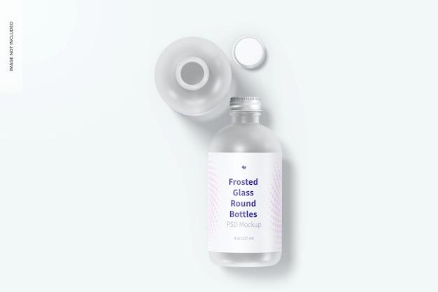 Мокап круглых бутылок из матового стекла на 8 унций