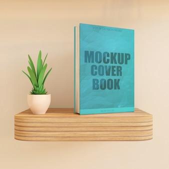 木製の壁の机または植物が付いている棚のブックカバーモックアッププレミアム