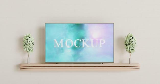 木製の壁の机の上のスマートテレビのモックアップ