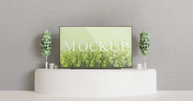 白いテーブルの上のテレビのモックアップ