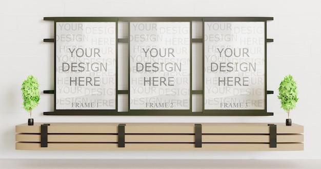 Три черные рамки макета на стене с деревянным столом