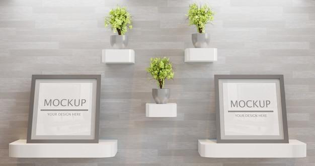 壁に植物の装飾が付いているカップル正方形フレームモックアップ