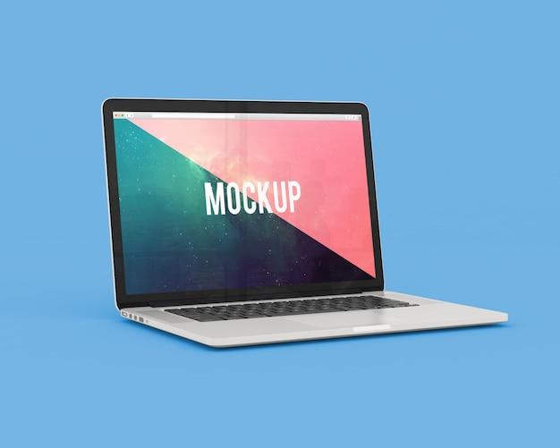 青い背景のノートパソコンは、モックアップ