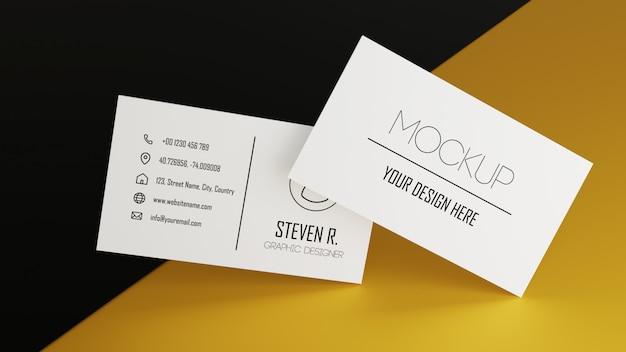 黄色の黒い色のテーブルにスタッキングホワイト名刺モックアップ