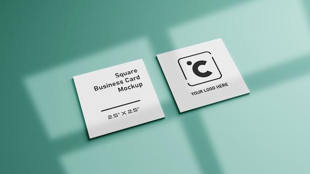 Белый квадратной формы макет визитной карточки на зеленый мятный пастельный цвет