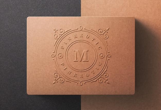 Роскошный логотип макет на бумажной коробке