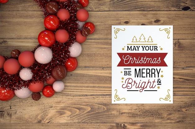 クリスマスカードモックアップと花輪