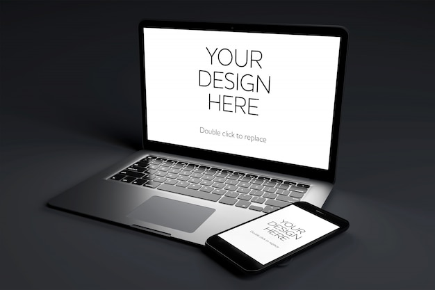 黒い部屋でモックアップの画面を持つラップトップコンピューターデバイス