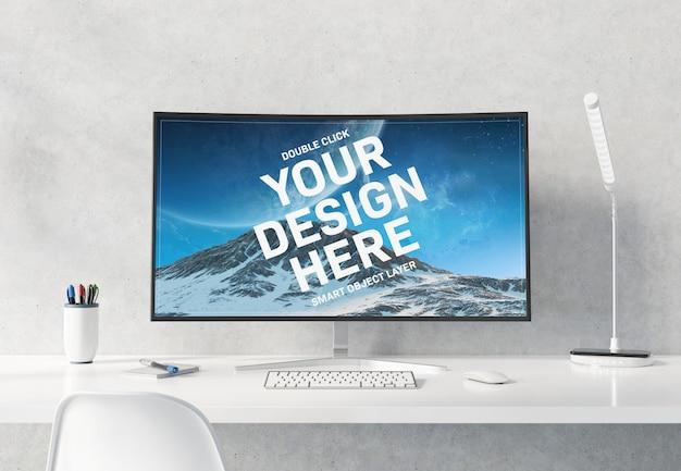 白いデスクトップインテリアモックアップに湾曲したモニター