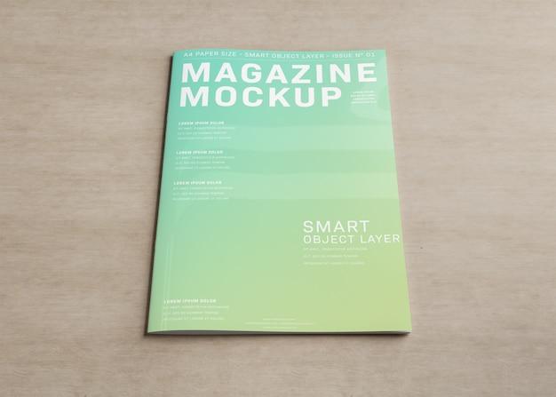 木製の表面のモックアップの雑誌の表紙
