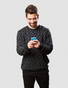 携帯電話で入力する若い男