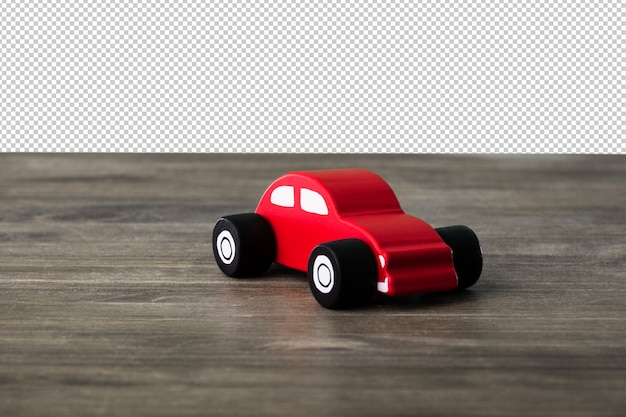 木の表面に車のおもちゃ
