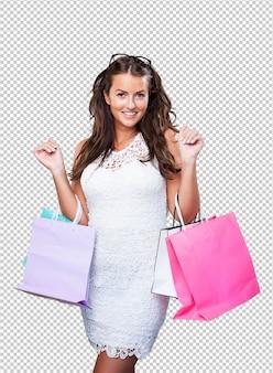 買い物袋を持つかなり若い女性