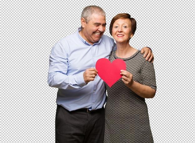 Среднего возрасте пара празднует день святого валентина