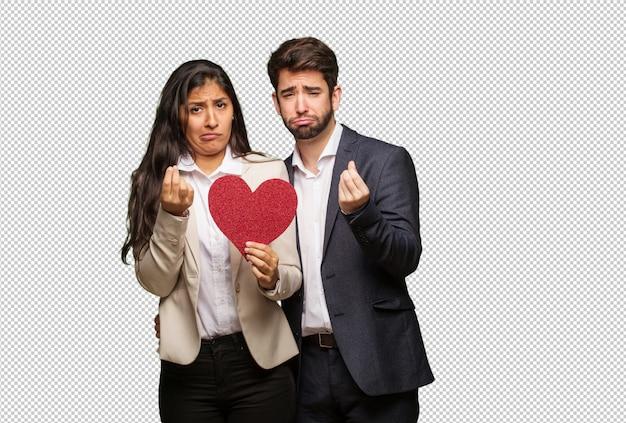 バレンタインデーのジェスチャーをしている若いカップル