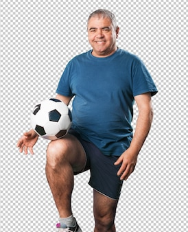 中高年の男性がサッカーボールで遊ぶ