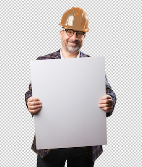 建築家の男、バナーを保持