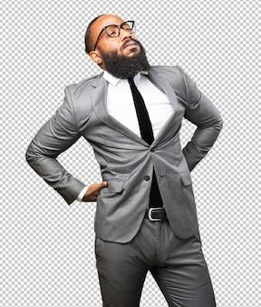 背中の痛みに苦しんでいるビジネス黒人男性