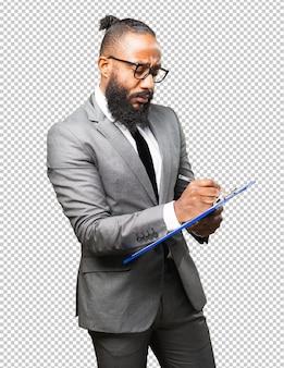 Бизнес черный человек, держащий инвентарь